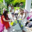 Diverse group of family and friends enjoy refreshment in the garden on a sunny day — Stock Video