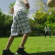 Cute young boy playing sports with his father, in the garden on a summer day — Wideo stockowe #44380927