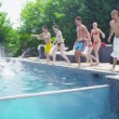 Friends jump into pool — Stock Video