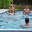 Friends enjoying pool party — Stock Video #44435827
