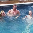 Friends pose in swimming pool — Stock Video #44436455