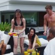 Mixed ethnicity friends enjoying pool party — Stock Video #44438499