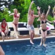 Friends pose in swimming pool — Stock Video #44439455