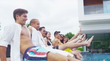 Attractive mixed ethnicity group of friends enjoying summer pool party — Stock Video