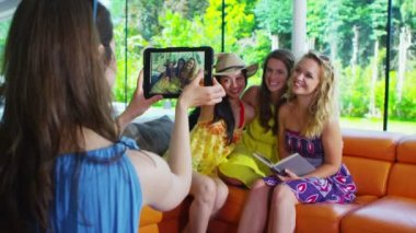 Happy group of friends posing and taking photos of themselves with tablet computer — Stock Video