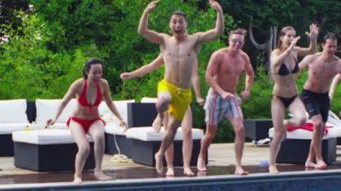 Friends jumping into swimming pool — Stock Video