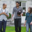 Mixed ethnicity students walk around university — Stock Video #44455673