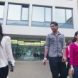 Students leaving their university — Stock Video #44457381