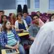 Students listening as teacher holds lecture — Stock video #44457409
