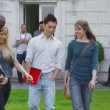 Mixed ethnicity students walk around university — Stock Video #44457555