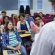 Students listening as teacher holds lecture — Stock video #44457693