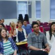 Students listening as teacher holds lecture — Stock Video