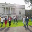 Mixed ethnicity students walk around university — Stock Video #44459879