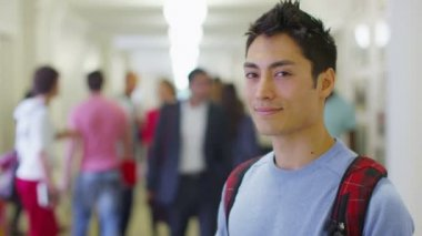 Male asian student standing in hallway — Stock Video