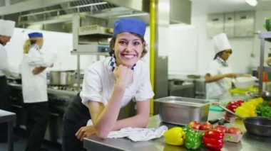 Smiling chef in commercial kitchen — Stock Video