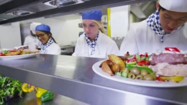 Mixed ethnicity team of professional chefs — Stock Video