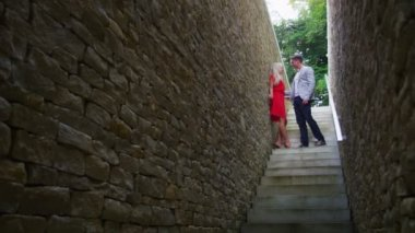Couple walking down set of stone stairs — Stock Video