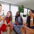 Female friends chatting over cocktails — Stock Video #44703149