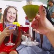 Happy female friends drinking cocktails — Stock Video #44703595