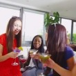Happy female friends drinking cocktails — Stock Video #44705267