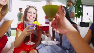 Happy female friends drinking cocktails — Stock Video