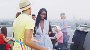 Friends enjoying rooftop barbecue — Video Stock