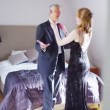 Mature couple getting ready for an evening out — Stock Video #44741123