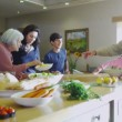 Happy family preparing meal together — Stock Video