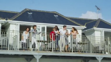 Friends on vacation go out on balcony — Stock Video