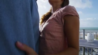 Couple share kiss on balcony — Stock Video