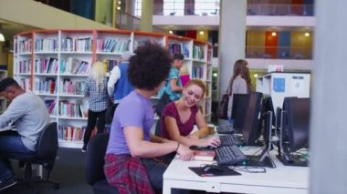 Student group in college library — Stock Video