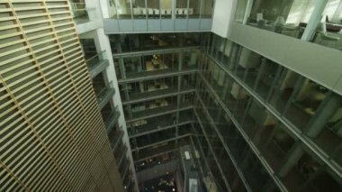 Office building with central atrium — ストックビデオ