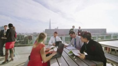 Business colleagues chat on office roof terrace — Stock Video