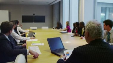 Diverse business team engaged in a conference call in boardroom meeting — Stock Video
