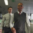 Businessmen chat together as they walk through modern office — Stock Video #44834719