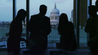 Business group in silhouette shake hands at the end of a meeting — Stock Video
