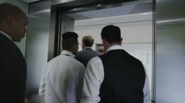 Diverse business group step out of elevator in modern office building — Stock Video