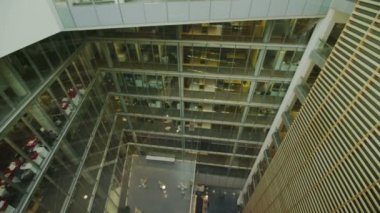 Office building with central atrium — Stock video