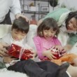 Brother and sister surprised by gifts — Stock Video #45157417