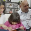 Asian happy family with tablet — Stock Video #45158197