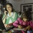 Mother on computer while daughter plays — Stock Video