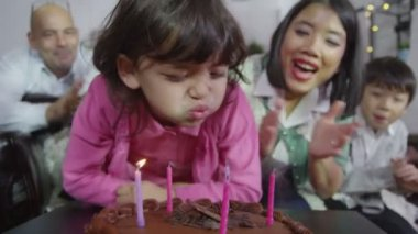Girl blow candles on birthday cake — Stock Video
