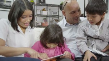 Asian happy family with tablet — Stock Video