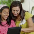 Mother and daughter spending time together and using a digital tablet — Stock Video #45205547