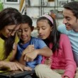 Happy family spending time together using a digital tablet — Stock Video #45205549