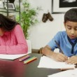 Brother and sister at home, writing and drawing with lots of colored pencils — Stock Video #45205551