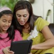 Mother and daughter spending time together and using a digital tablet — Stock Video #45205643