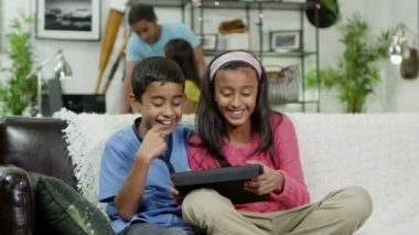 Young boy and girl playing on a digital tablet — Stock Video