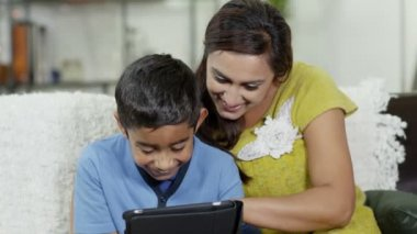 A mother and son spending time together and using a digital tablet — Stock Video