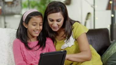 Mother and daughter spending time together and using a digital tablet — Stock Video
